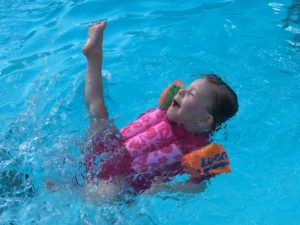 eve swimming with leg in the air